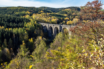 Colorful autumn forest with the Hetzdorfer Viaduct in the Ore Mountains,Saxony,Germany