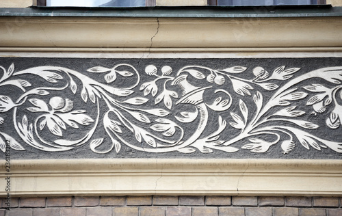 Decorative ornamental frieze with 19th century graffito in Prague, Czech.