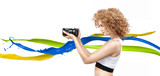Cheerful frizzy-haired lady holding a long-focus lens - 236186430