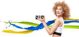 Cheerful frizzy-haired lady holding a long-focus lens - 236186436