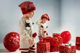 Portrait of adroable twin-elves among huge Christmas presents - 236186455