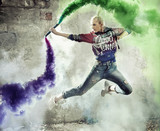 Flexible girl dancer holding a colorful flare - 236186645