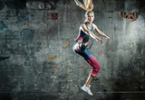 Blonde athlete lady in a jump pose - 236186681