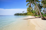 A nice and empty beach in a tropical desert island of Sumatra, Indonesia. Blue sky, white sand and coconut trees, a dream holiday place to relax, ses, a dream holiday place to relax, snorkel and rest.