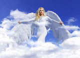 Conceptual portrait of a blond angel flying up to the sky - 236195838