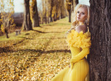 Portrait of a blonde wearing a flowery, golden gown - 236195869