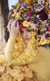 Attractive blonde wearing a flowery crown - 236195882