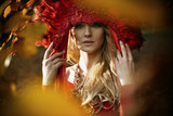 Beautiful blond woman wearing a red coronet - 236196235