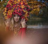 Beautiful blond nymph wearing impressive, colorful coronet - 236196242