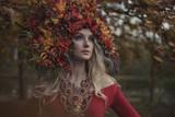Beautiful blond nymph wearing impressive, colorful coronet - 236196260
