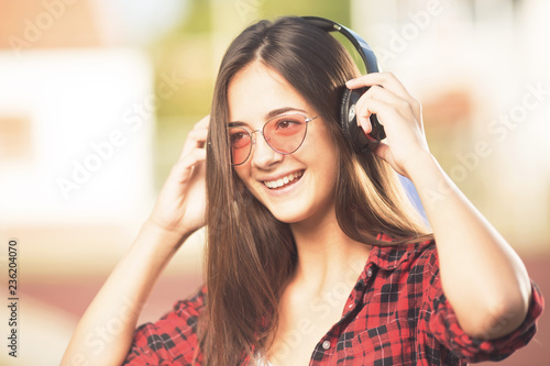 Beautiful happy teenage girl listening to music - 236204070