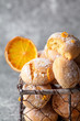 Homemade orange crinkle cookies  in small metal basket on gray background, vertical composition
