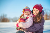 Little girl and her mother playing outdoors at sunny winter day - 236231802