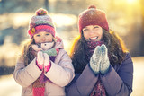 Little girl and her mother playing outdoors at sunny winter day - 236232006