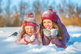 Little girl and her mother playing outdoors at sunny winter day - 236232045