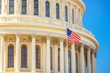 US Capitol and flag over blue sky - 236232215