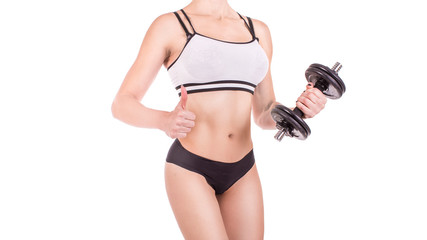 Torso of a young fit woman lifting dumbbells isolated on white background. © Stavros