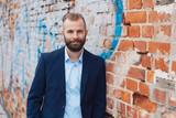 Entrepreneurial man wearing suit in urban setting