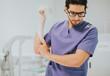 Leinwandbild Motiv Male nurse putting on a glove