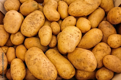 Leinwanddruck Bild pile of fresh potatoes