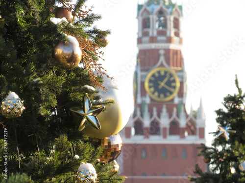 Moscow Kremlin and Christmas decorations on Red square. New Year tree in Russia, view of the Spasskaya tower and Kremlin chimes