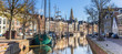 Leinwanddruck Bild - Panorama of historic ships and warehouses in the center of Groningen, The Netherlands