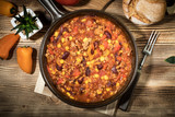 Chili con carne in a clay pan. - 236280824