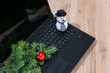 Laptop computer, Christmas tree branch and a snowman on a wooden table