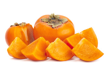 Persimmon fruit closeup on white