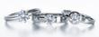 Leinwanddruck Bild - 3 Solitär-Diamantringe liegend auf Weiß