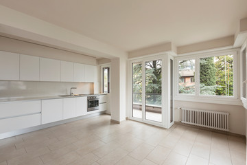 Open space with large windows and modern kitchen