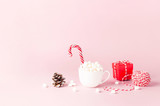 White mug with marshmallows Candy Cane, red gift box, pine cone, decorative lace on pink background Flat Lay Winter traditional drink food Festive decor. Christmas New Year presents Xmas holiday - 236302401