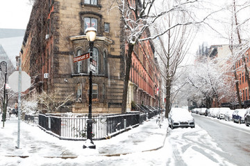 Snowy winter scene at the historic intersection of 10th and Stuyvesant Street in the East Village of Manhattan, New York City