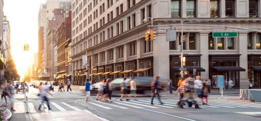 New York City street scene with crowds of people walking in Midtown Manhattan