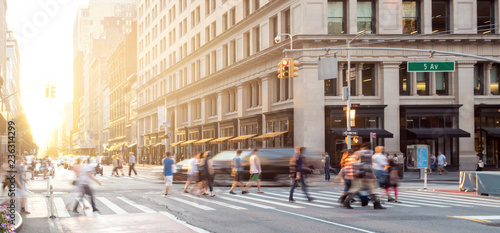 Leinwanddruck Bild New York City street scene with crowds of people walking in Midtown Manhattan and sunlight background
