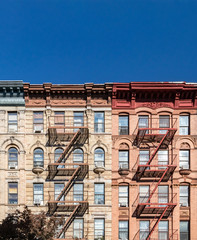 Empty blue sky above old buildings in the East Village neighborhood of New York City