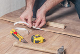Master Class for installing and installing floor sills - the master removes protective paper from adhesive tape - 236320451