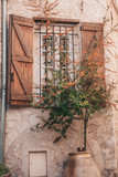 Typical window with wooden shutters in the Provencal style
