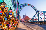 View of the pedestrian Tumski Bridge (is also called Lovers Bridge, Cathedral Bridge or Green Bridge), adorned with many love locks and hearts, Wroclaw, the Poland, January, 2018