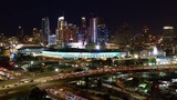 Urban aerial time lapse of the downtown Los Angeles convention center, skyline and freeway traffic at night. - 236348608