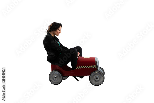 Businesswoman drives a toy car. Isolated on white background