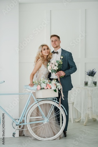 Photo shoot of the newlyweds in a light photo Studio.