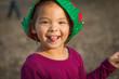 Cute Mixed Race Young Baby Girl Having Fun Wearing Christmas Hat Outdoors