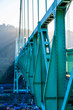Truss of St Johns Bridge over Willamette River in the sunlight