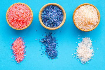 Colorful bath salt pink and blue on blue background top view © 9dreamstudio
