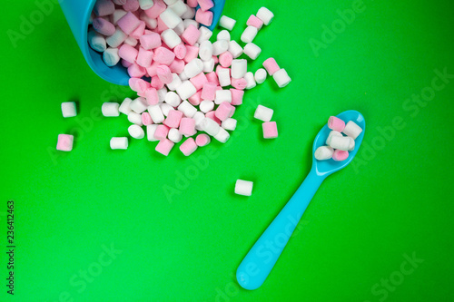 sweet marshmallow, candy on green background, top view - 236412463