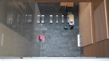 Birds eye view of people walking into a building. - 236434831