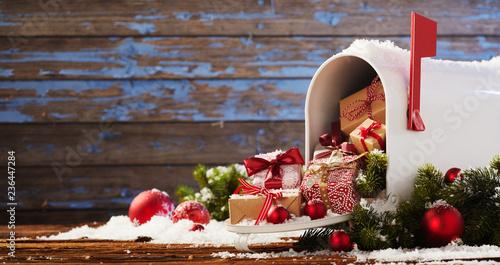 Leinwandbild Motiv Mailbox overflowing with Christmas presents