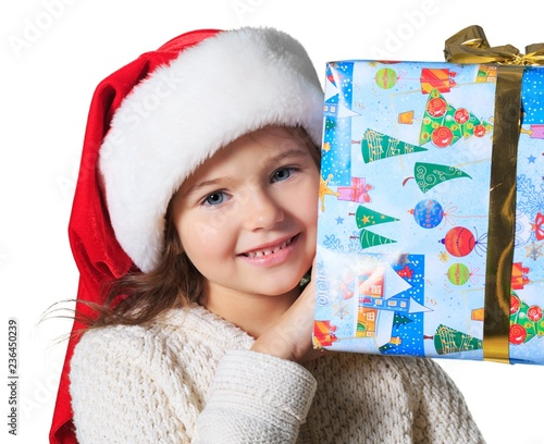 Child holding a gift. - 236450239