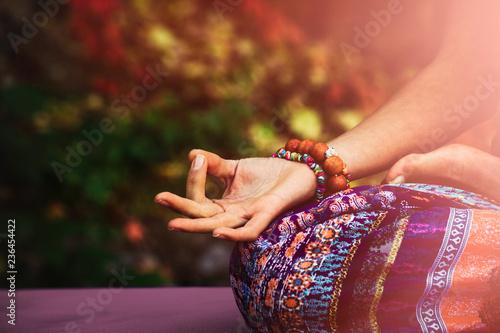 Leinwandbild Motiv closeup of woman hand in mudra gesture practice yoga meditation outdoo
